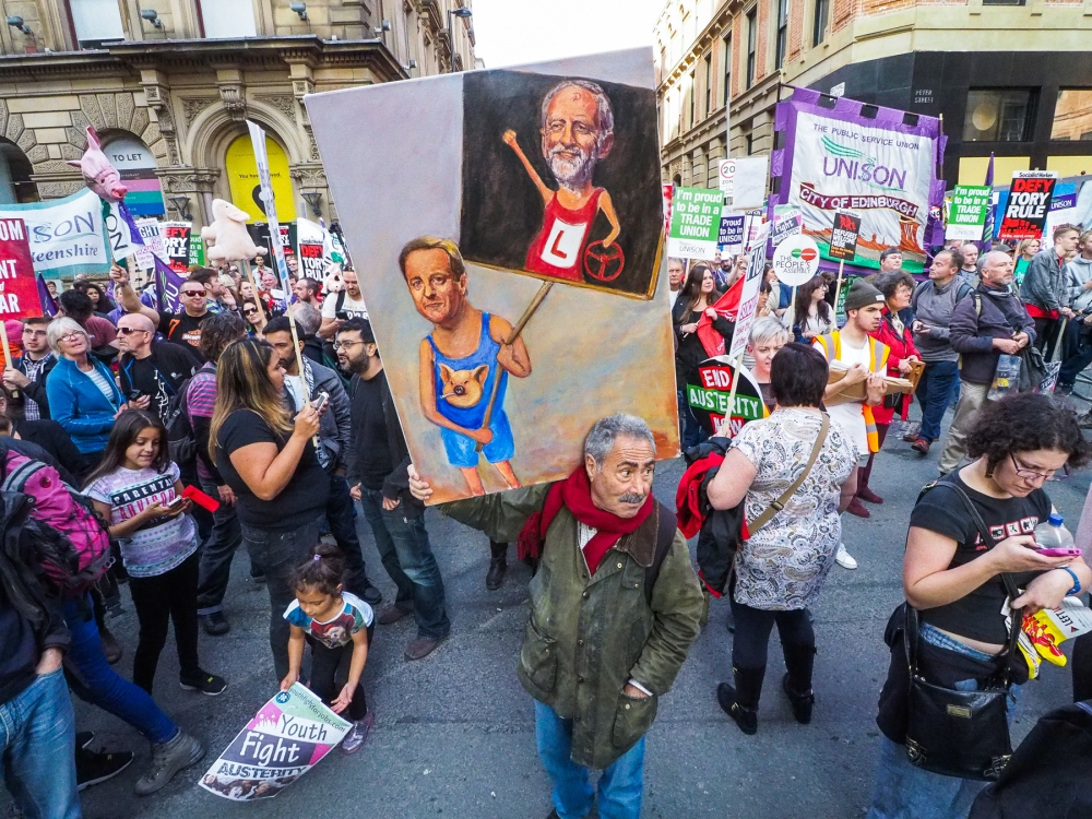 "Political artist Kaya Mar unveiled his latest satirical artwork at the ""Take Back Manchester"" anti-austerity protest, which saw over 80,000 protesters marching noisily through the city as the Conservative Party annual conference opened."