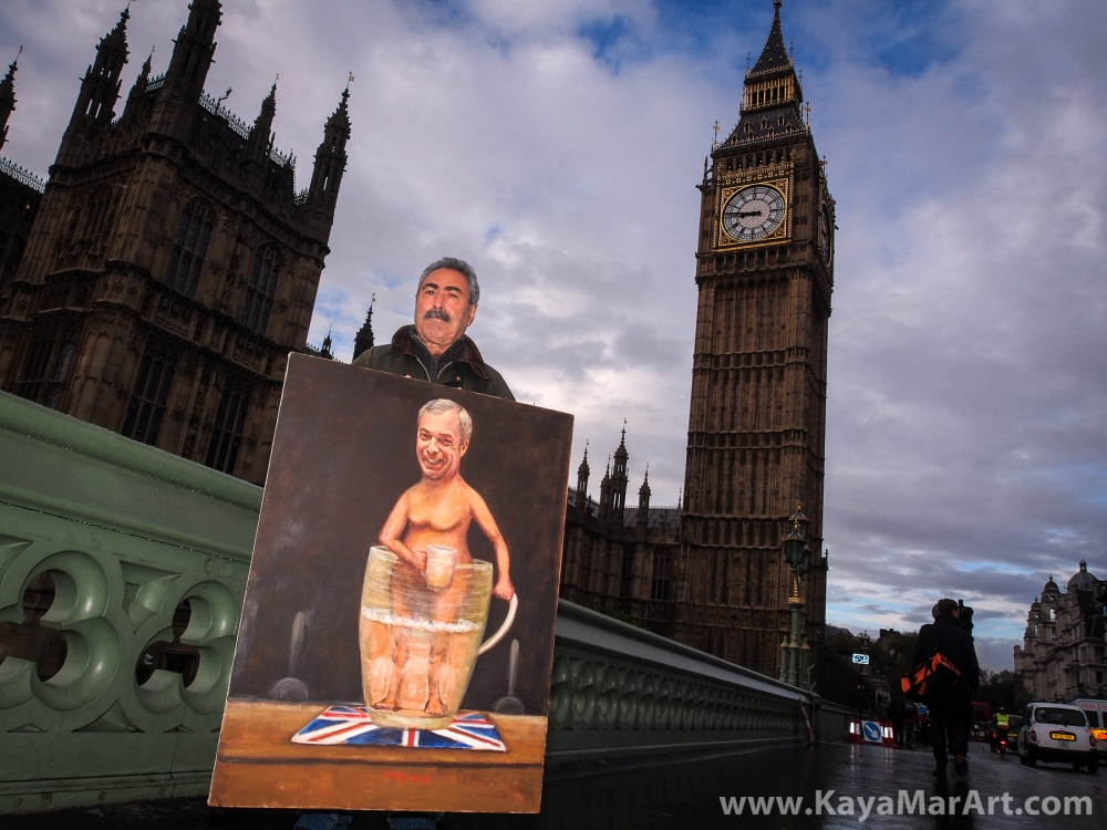 Political artist Kaya Mar outside Parliament shows his painting of UKIP leader Nigel Farage standing naked in a huge glass of beer